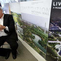 """In a photo taken April 5, 2012, Donald Stastny, an architect advising the Trust for the National Mall, is surrounded by boards depicting proposed designs for the National Mall during an interview in Washington. The Trust for the National Mall, a nonprofit group seeking to raise money and support to restore parts of the National Mall, is unveiling final design concepts for three parts of """"America's front yard,"""" areas overused and neglected for years near the U.S. Capitol, the Washington Monument and Constitution Gardens, which competing architects and designers seek to renew."""