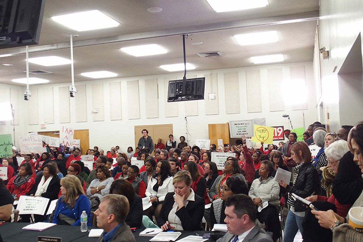 Hundreds of teachers attend the Shelby County School Board meeting in January to express concern about the district's performance-based pay plan.