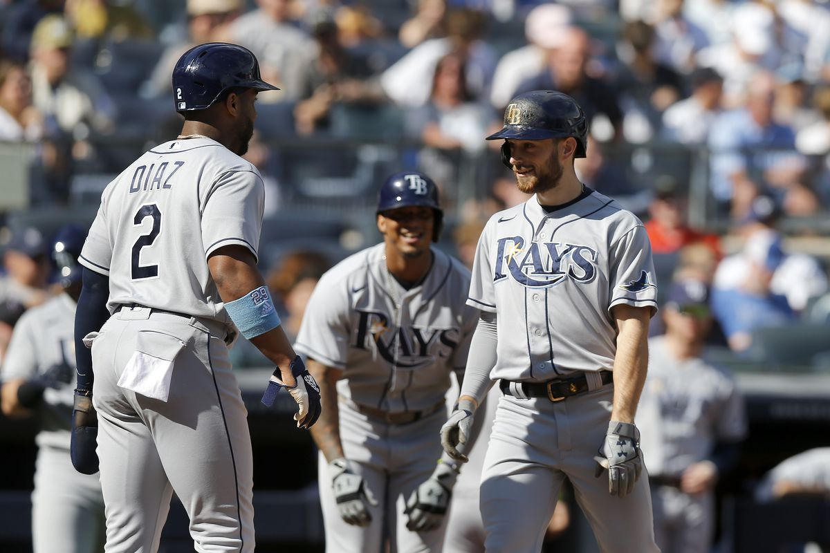 Brandon Lowe #8 of the Tampa Bay Rays celebrates his third inning three run home run against the New York Yankees with teammates Yandy Diaz #2 and Wander Franco #5 (C) at Yankee Stadium on October 02, 2021 in New York City.