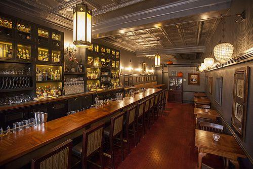 A narrow, brightly-lit bar space