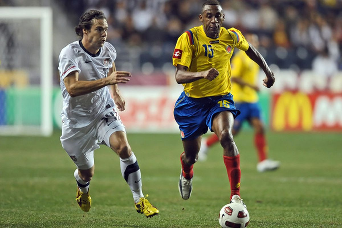 CHESTER, PA - OCTOBER 12: Heath Pearce #14 of the United States and Jhon Viarfara #15 of Colombia chase down the ball at PPL Park on October 12, 2010 in Chester, Pennsylvania. The game ended in a 0-0 tie. (Photo by Drew Hallowell/Getty Images)
