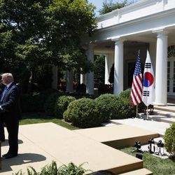 President Donald Trump listens as South Korean President Moon Jae-in speaks during a joint statement in the Rose Garden of the White House in Washington, Friday, June 30, 2017.
