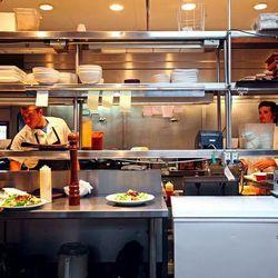 Executive chef Joseph Arena works the line with Sam Proia.