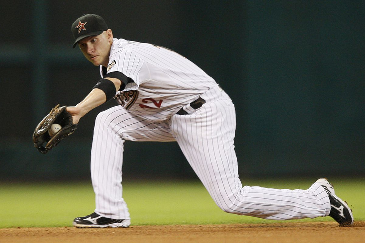 HOUSTON - AUGUST 30:  Shortstop Clint Barmes #12 of the Houston Astros makes a play during a game against the Pittsburgh Pirates at Minute Maid Park on August 30, 2011 in Houston, Texas.  (Photo by Bob Levey/Getty Images)