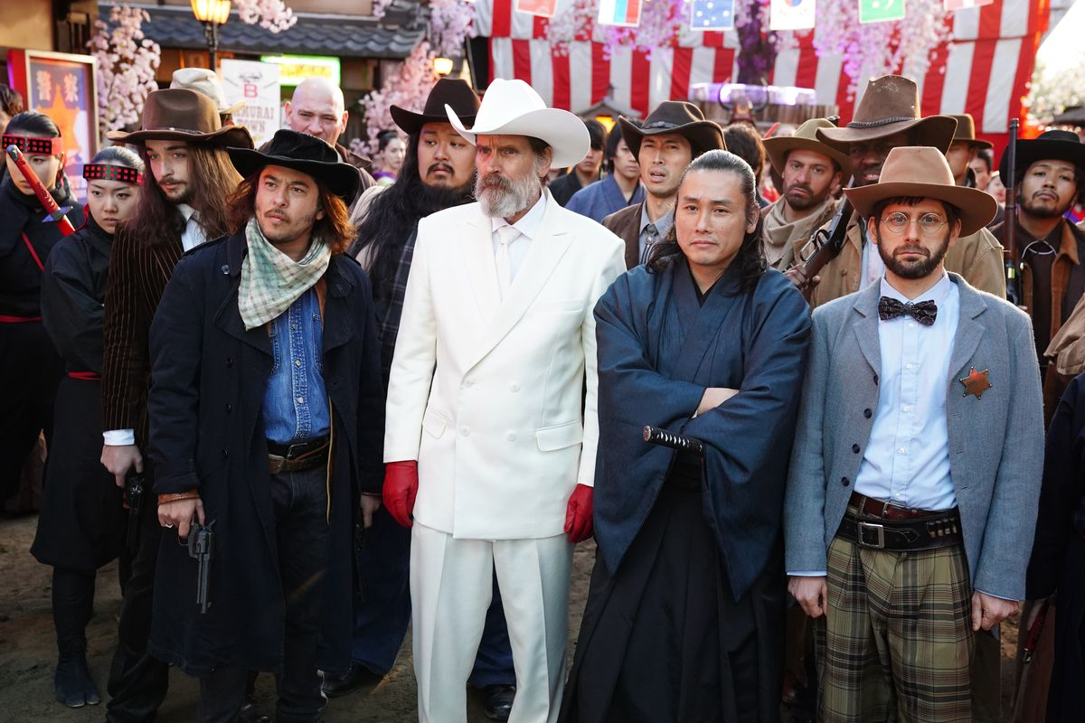 the governor in the white costume and cowboy hat stands with other cowboy samurai in Prisoners of the Ghostland