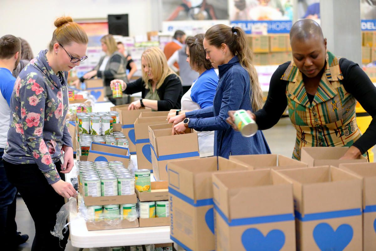 FILE - USANA employees box up 100,000 meals at USANA's corporate offices in Salt Lake City on Tuesday, Nov. 28, 2017, in celebration of National Day of Giving. The meals will be distributed to hungry and malnourished families living in the Salt Lake Valle
