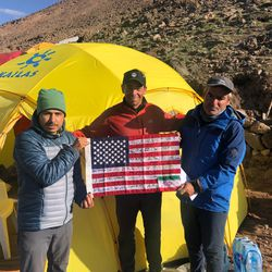 Utahns David Roskelley (middle holding the flag), Greg Paul and Kevin Paul climbed Iran's Mount Damavand in Iran in 2018.