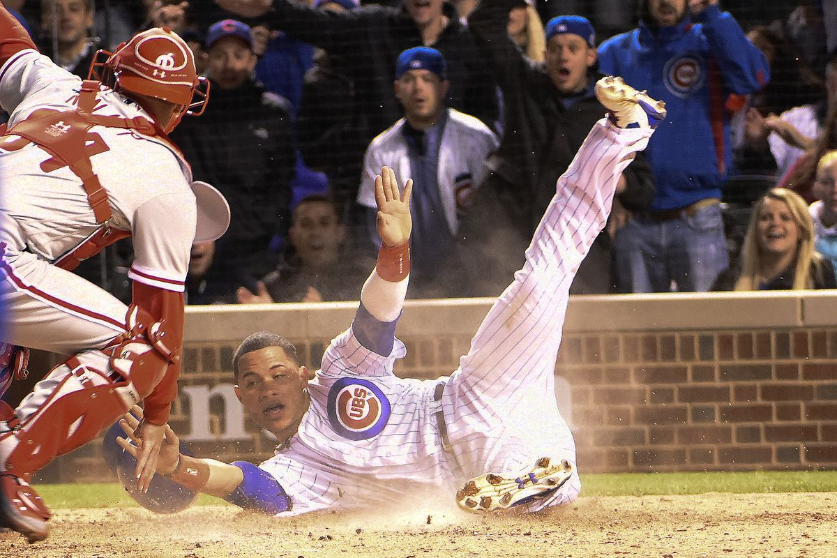 CHICAGO, IL - MAY 03:  Willson Contreras #40 of the Chicago Cubs scores as Andrew Knapp #34 of the Philadelphia Phillies makes a late tag during the sixth inning on May 3, 2017 at Wrigley Field  in Chicago, Illinois. (Photo by David Banks/Getty Images)