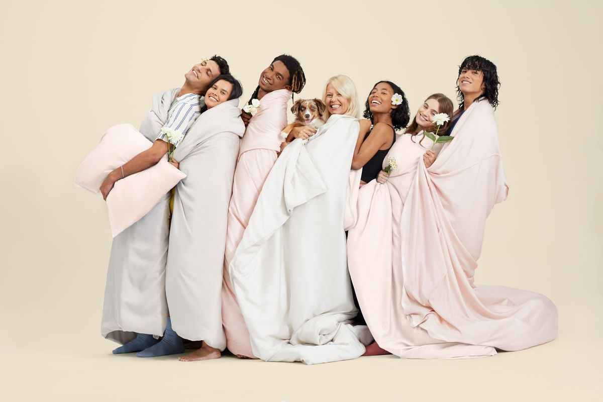 Women wrapped in sheets