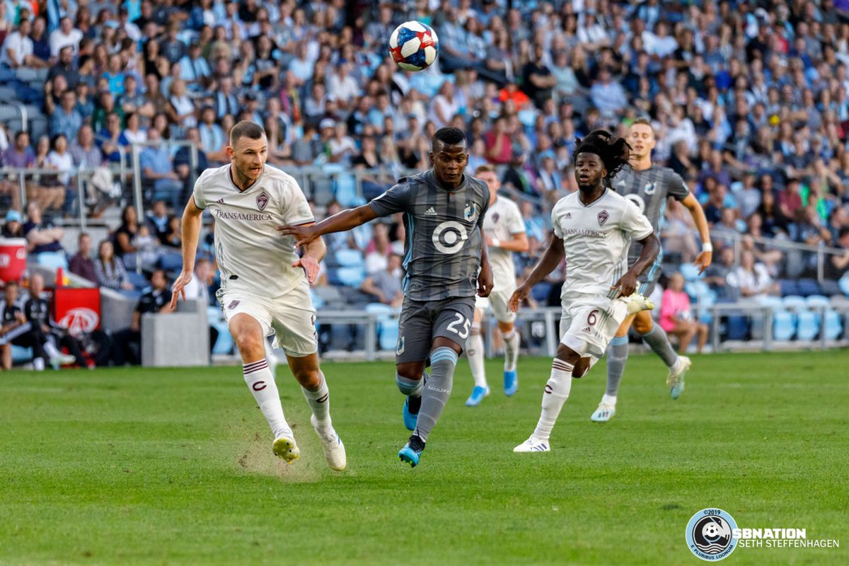 August 14, 2019 - Saint Paul, Minnesota, United States - Colorado Rapids defender Tommy Smith (5) and Minnesota United forward Darwin Quintero (25) chase down a ball during the match at Allianz Field.