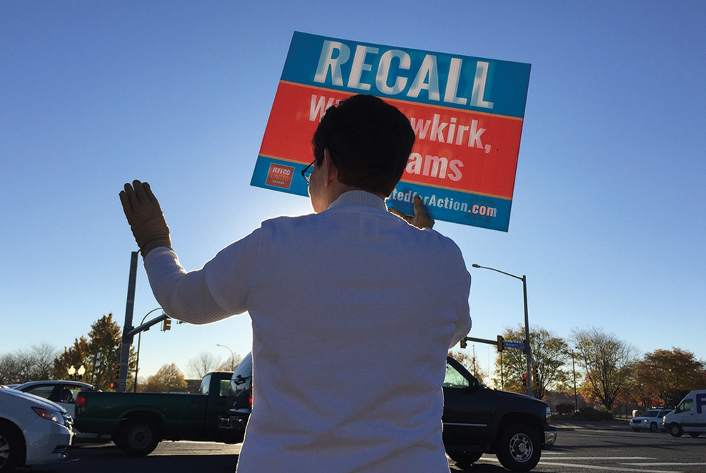 Recall supporter Cecelia Lange waved signs at 52nd and Wadsworth Tuesday morning.