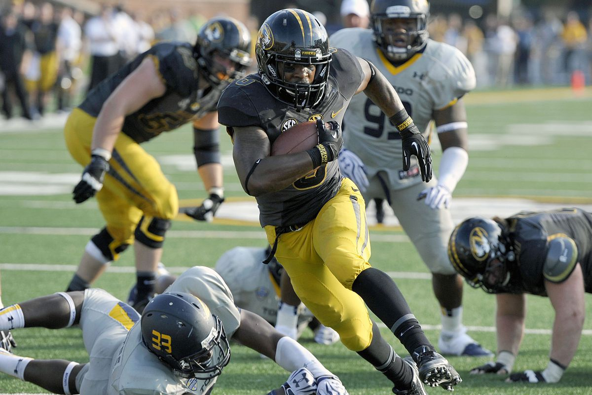Missouri running back Marcus Murphy scores a touchdown against Toledo 2013 in Columbia, Mo.