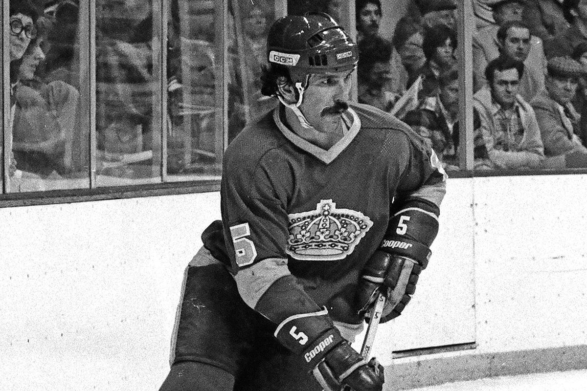 BOSTON, MA - 1970s: Bob Murdoch #5 of the Los Angeles Kings skates with puck in game against the Boston Bruins at Boston Garden.