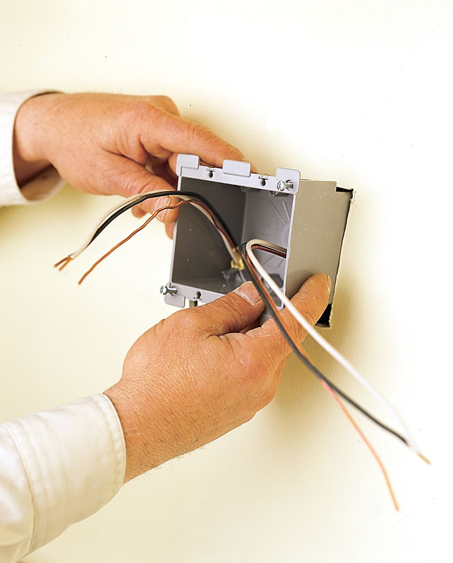 Man Installs New Electrical Box For Under Cabinet Kitchen Lighting