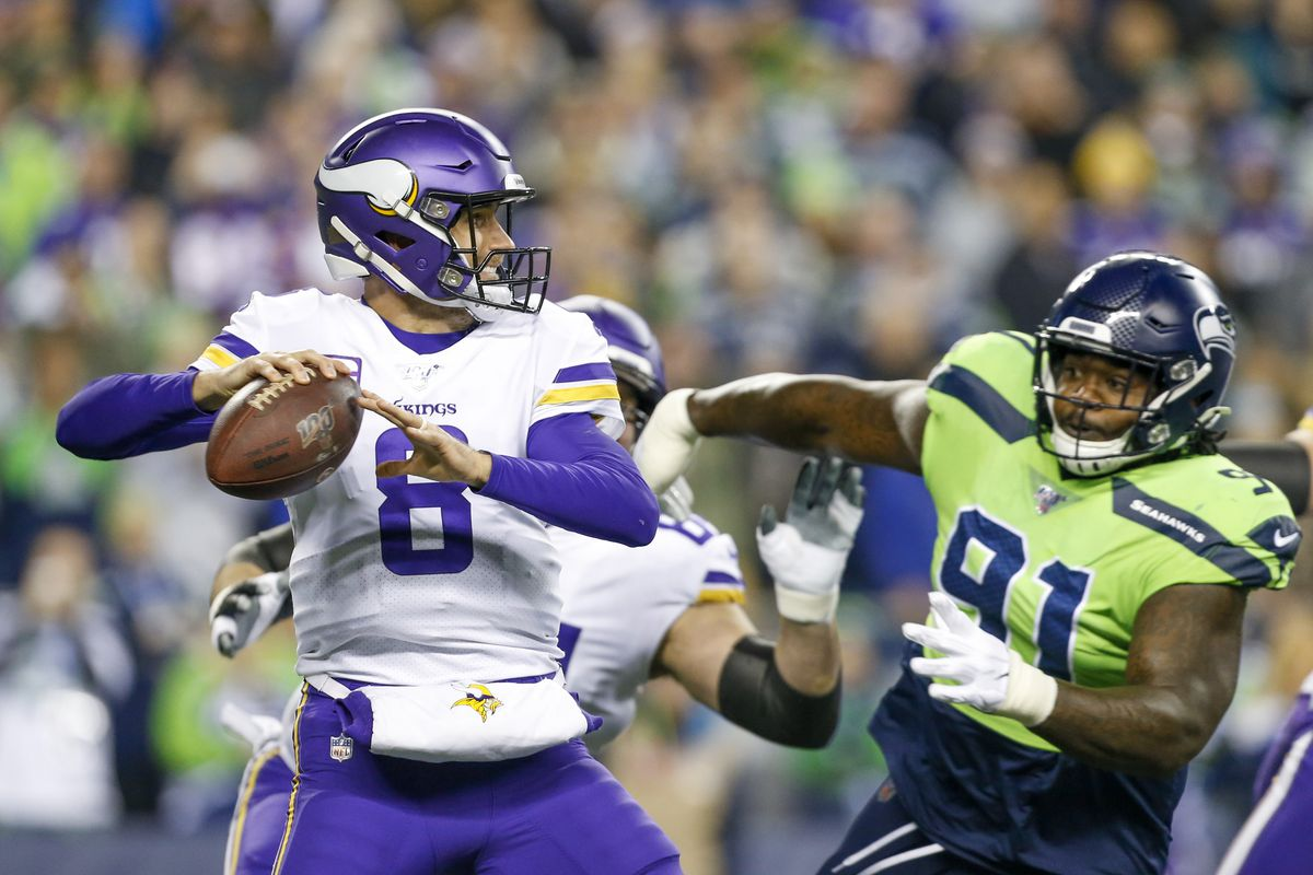 Minnesota Vikings quarterback Kirk Cousins drops back to pass against Seattle Seahawks defensive tackle Jarran Reed during the first quarter at CenturyLink Field.