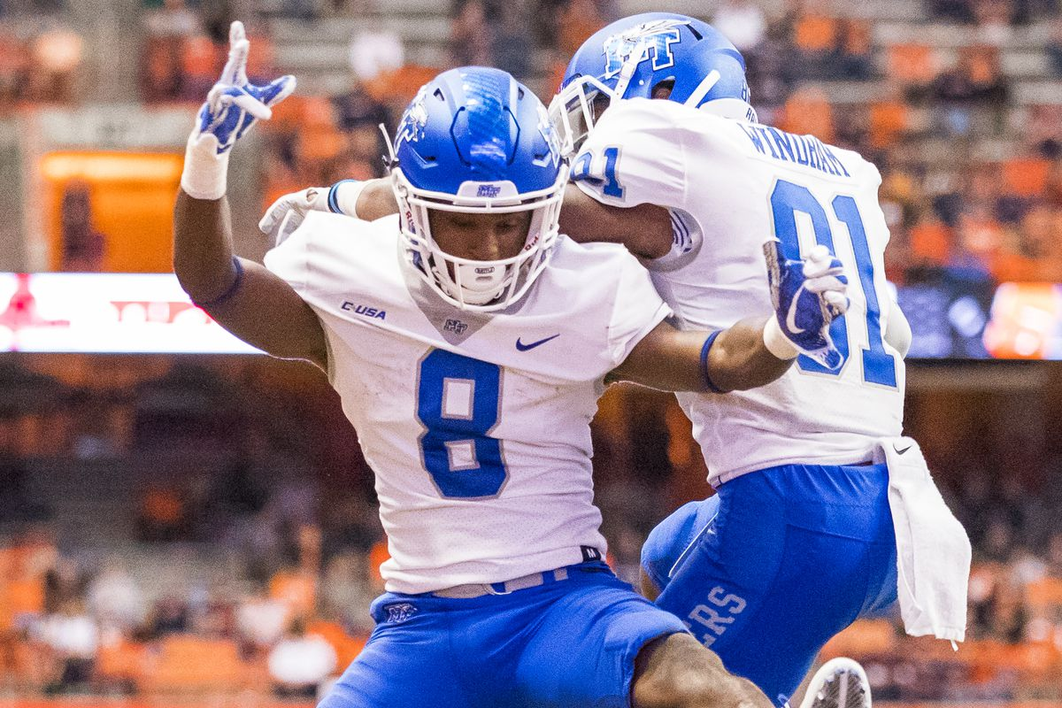 SYRACUSE, NY - SEPTEMBER 09:  Ty Lee #8 of the Middle Tennessee Blue Raiders is congratulated for a touchdown reception during the fourth quarter against the Syracuse Orange by teammate CJ Windham #81 on September 9, 2017 at The Carrier Dome in Syracuse, New York. Middle Tennessee defeats Syracuse 30-23.  (Photo by Brett Carlsen/Getty Images)
