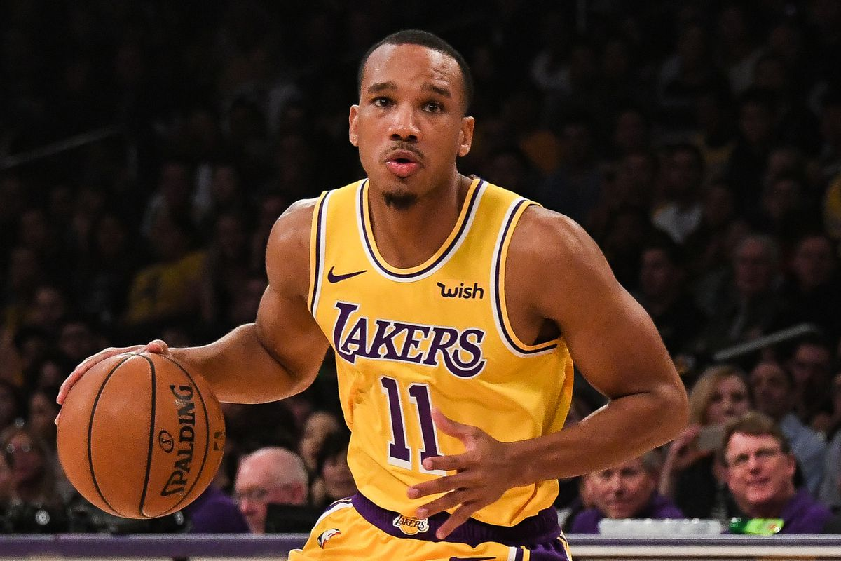 Los Angeles Lakers guard Avery Bradley works around Memphis Grizzlies defense during the first quarter at Staples Center.