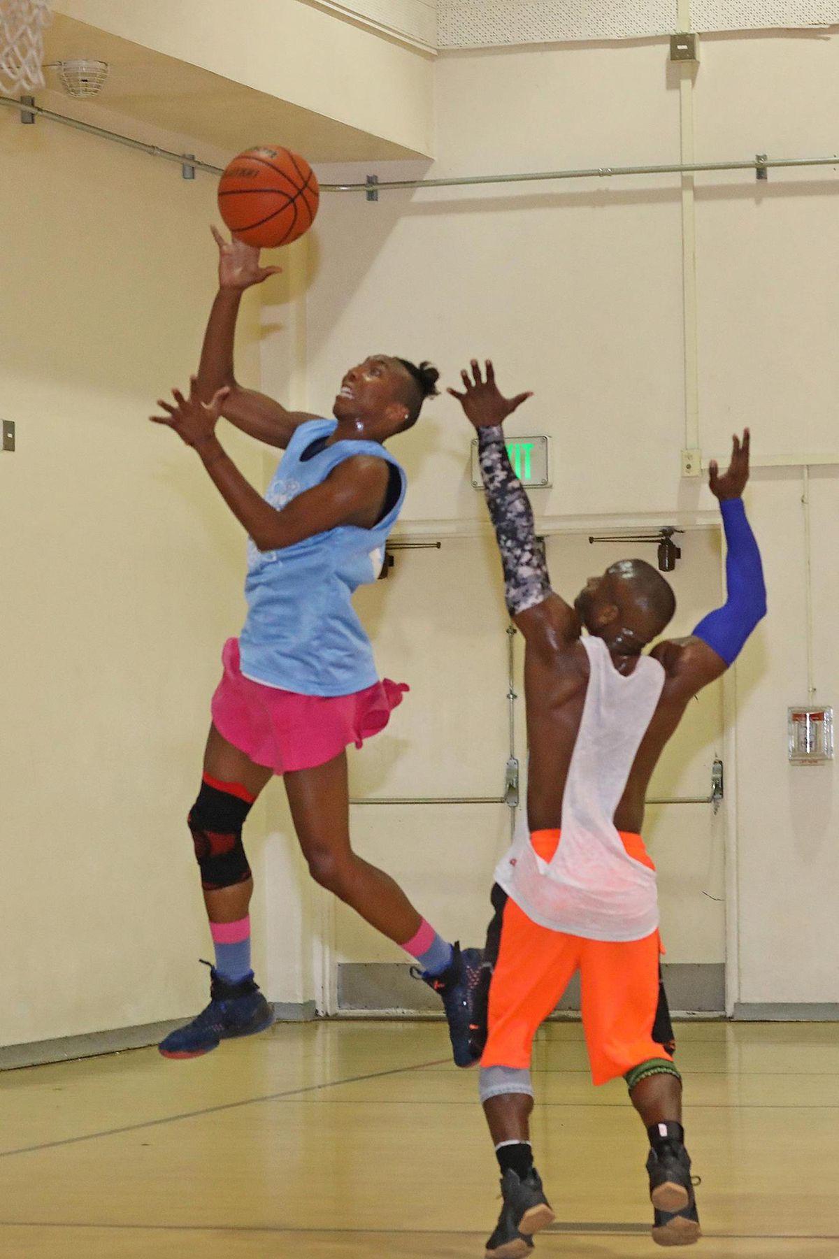 Navi Huskey plays basketball.