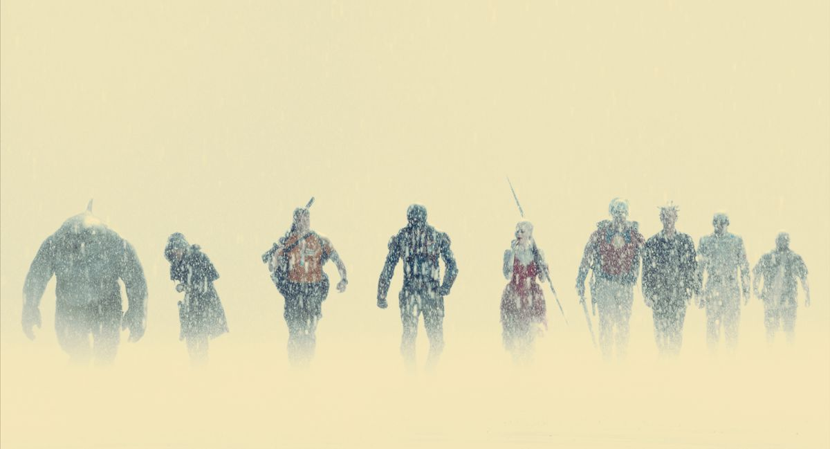 The Suicide Squad walks through the rain and fog in The Suicide Squad