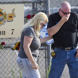 David Turbyfill of Prescott, the father of Travis Turbyfill, who was killed fighting the Yarnell Hill Fire is comforted by his wife, Shari Turbyfill (not Travis' mother) in front of Prescott Fire Station #7 on Monday, July 1, 2013. Nineteen firefighters have died in the Yarnell Hill Fire that has ripped through half of the town and sent residents to Prescott for safety. (AP Photo/The Arizona Republic, David Wallace)