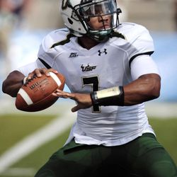 South Florida quarterback B.J. Daniels throws against Nevada during the first half of an NCAA college football game, Saturday, Sept. 8, 2012, in Reno, Nev.