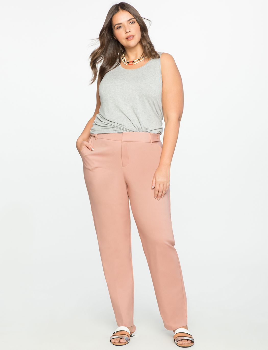 A model in pink pants and a gray tank top