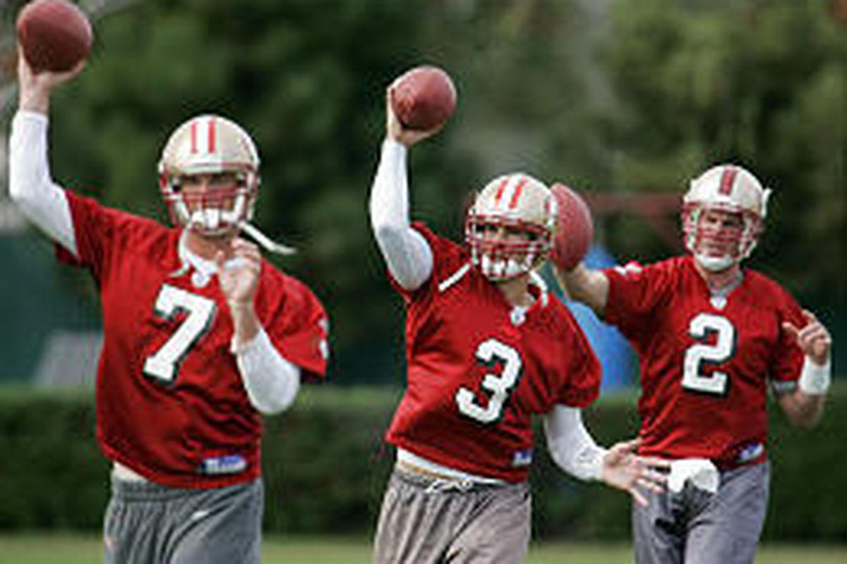 New San Francisco 49ers quarterback Jesse Palmer, right, works out with quarterback Cody Pickett, center, and quarterback Ken Dorsey, left, during practice at the 49ers headquarters in Santa Clara, Calif.