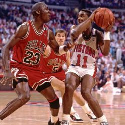AUBURN HILLS, MI – 1988: Isiah Thomas #11 of the Detroit Pistons stops his drives against Michael Jordan #23 of the Chicago Bulls during an NBA game in 1988 at The Palace in Auburn Hills, Michigan. NOTE TO USER: User expressly acknowledges and agrees that, by downloading and/or using this Photograph, user is consenting to the terms and conditions of the Getty Images License Agreement. Mandatory Copyright Notice: Copyright 1988 NBAE (Photo by Nathaniel S. Butler/NBAE via Getty Images)