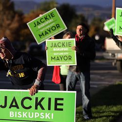 Miguel Gallegos, front, and other supporters of Salt Lake mayoral candidate Jackie Biskupski wave to motorists in Salt Lake City on Tuesday, Nov. 3, 2015.