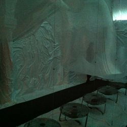 The first room, filled with fans and an undulating piece of fabrics. Walls were wrapped in white plastic.