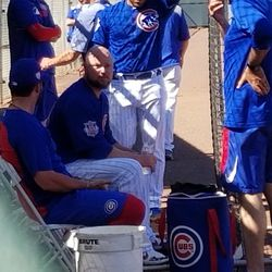 Jon Lester on the bench with the coaching staff between innings