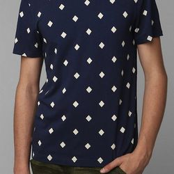 """<strong>Character Hero</strong> Allover Diamond Tee, <a href=""""http://www.urbanoutfitters.com/urban/catalog/productdetail.jsp?id=28913879&parentid=M_APP_POLOS"""">$20</a> at Urban Outfitters"""