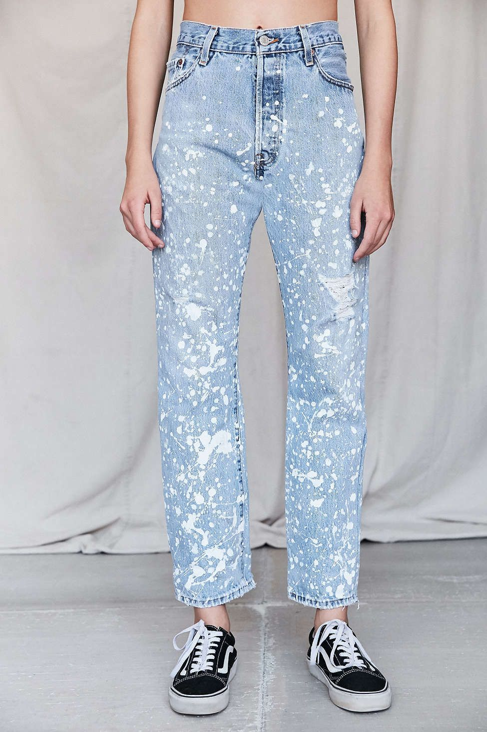 a model with white splatter painted jeans