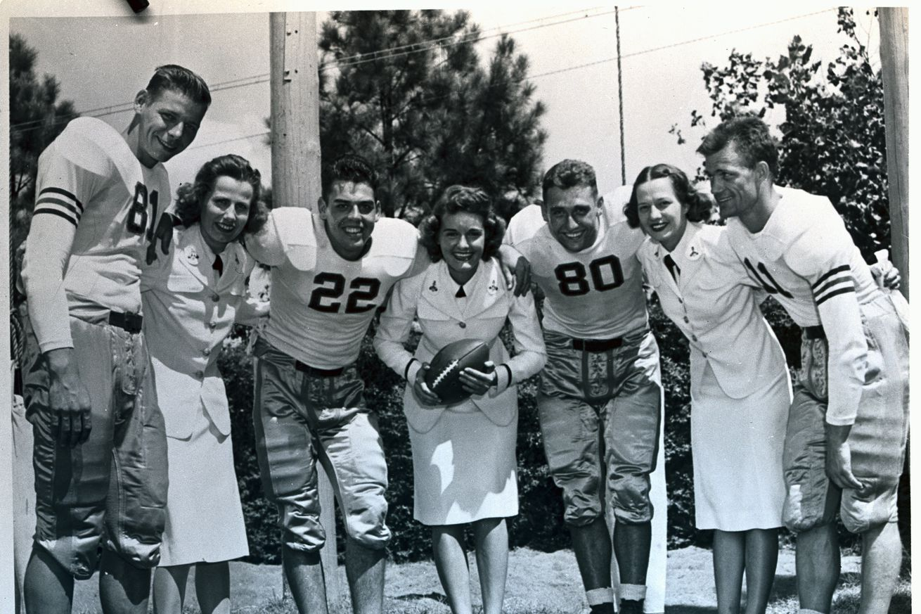 Football Players With Women in Uniforms