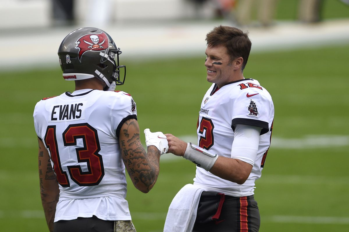 Tampa Bay Buccaneers quarterback Tom Brady (12) with wide receiver Mike Evans (13) on the field before the game at Bank of America Stadium.