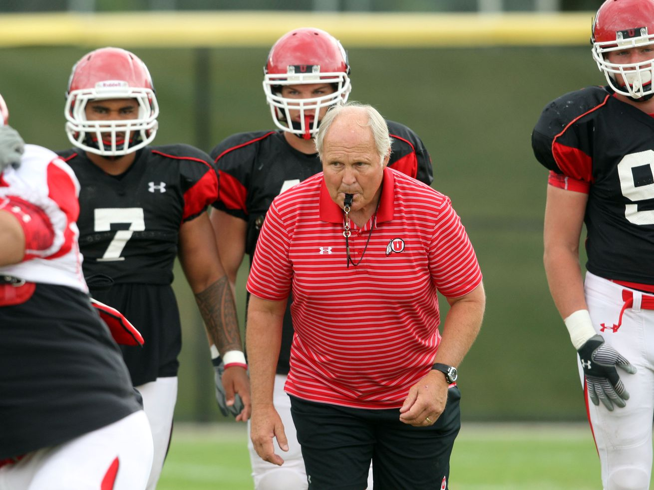 Utah defensive line coach John Pease watches players execute drills during a practice at the University of Utah, Aug. 19, 2010.