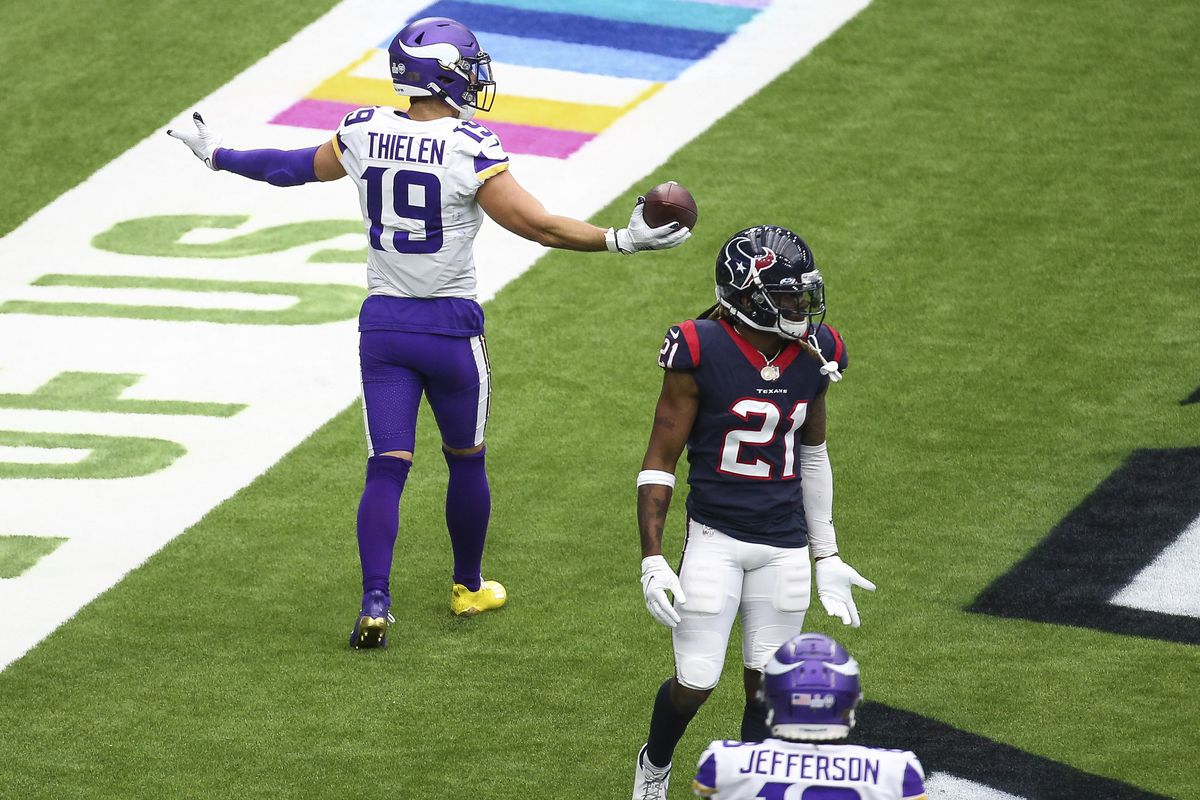 Minnesota Vikings wide receiver Adam Thielen (19) reacts after scoring a touchdown against the Houston Texans during the third quarter at NRG Stadium.