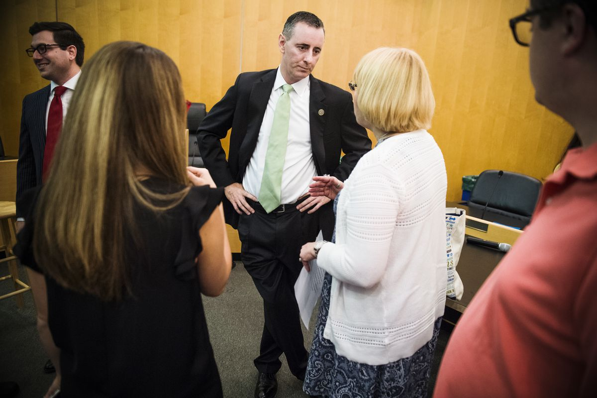 Rep. Brian Fitzpatrick (R-Pa.), talks with guests during a town hall meeting in Bensalem, Pa., on August 22, 2017.