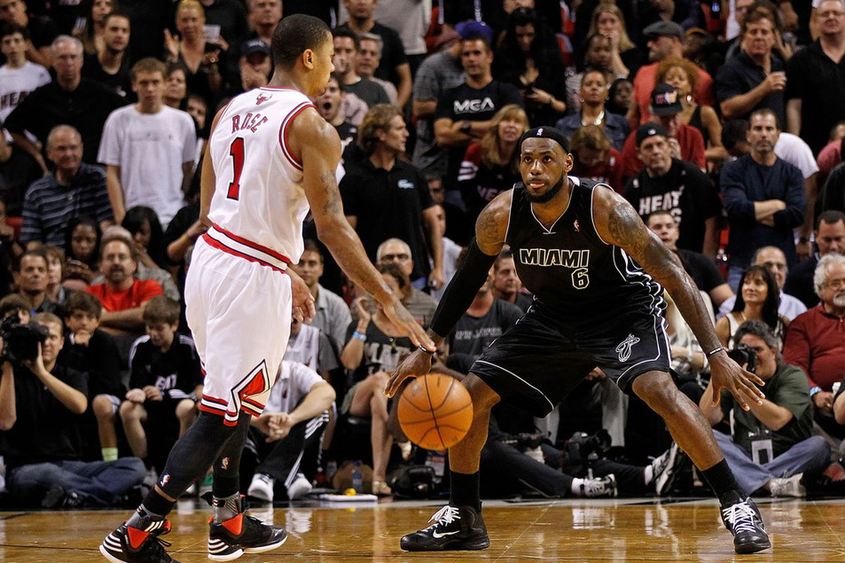 MIAMI, FL - JANUARY 29:  2012 NBA MVP candidates Derrick Rose and Lebron James square off during the Heat's 97-93 victory.