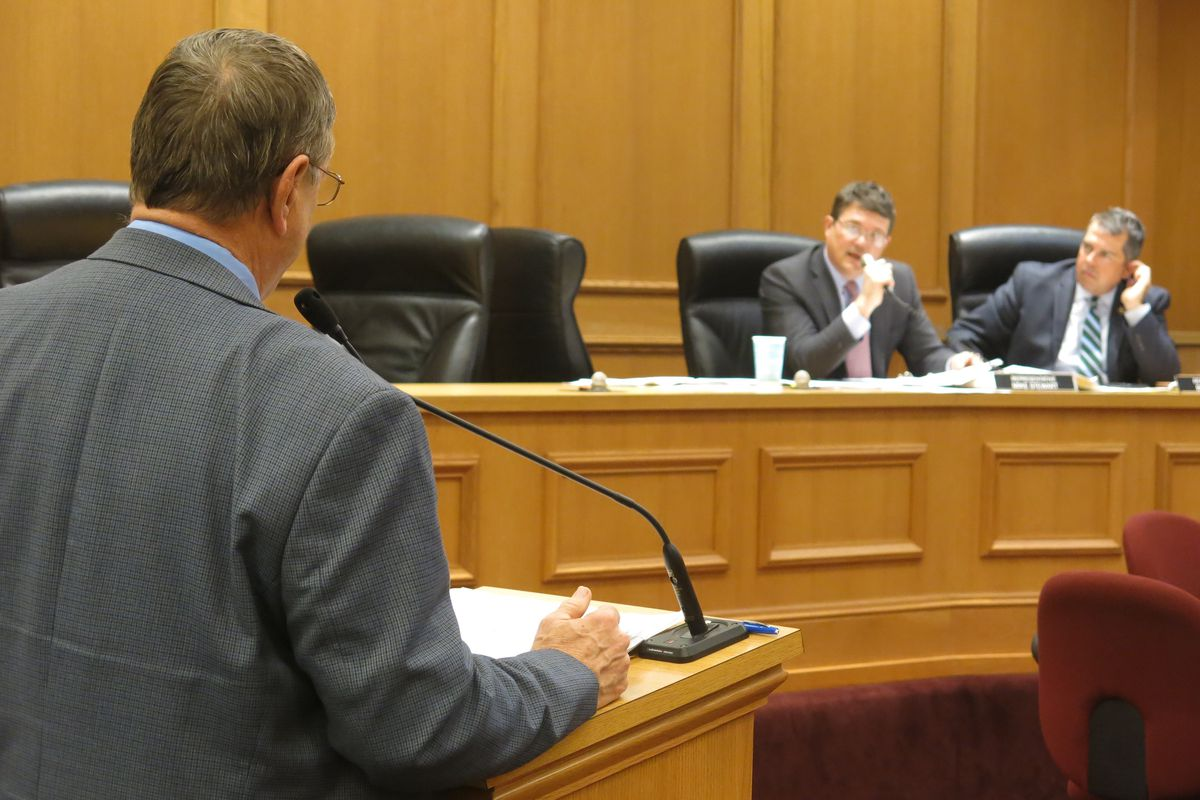 Rep. Harry Brooks, who is sponsoring a bill to pilot school vouchers in Memphis, answers questions from Rep. Mike Stewart during a House committee meeting on March 29.