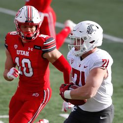 Washington State Cougars running back Max Borghi (21) carries the ball against Utah Utes safety R.J. Hubert (10) during an NCAA football game at Rice-Eccles Stadium in Salt Lake City on Saturday, Dec. 19, 2020.