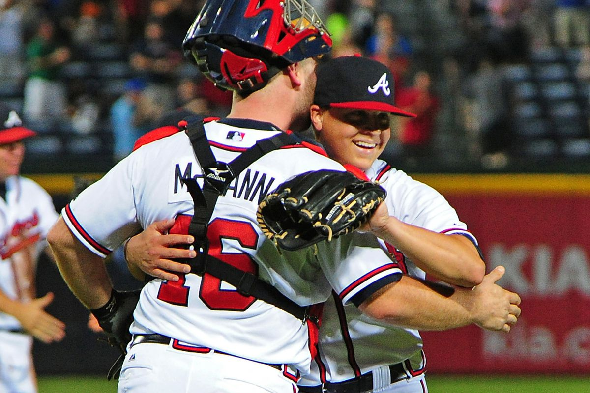 ATLANTA, GA - AUGUST 16: Kris Medlen #54 of the Atlanta Braves celebrates with Brian McCann #16 after the game against the San Diego Padres at Turner Field on August 16, 2012 in Atlanta, Georgia. (Photo by Scott Cunningham/Getty Images)