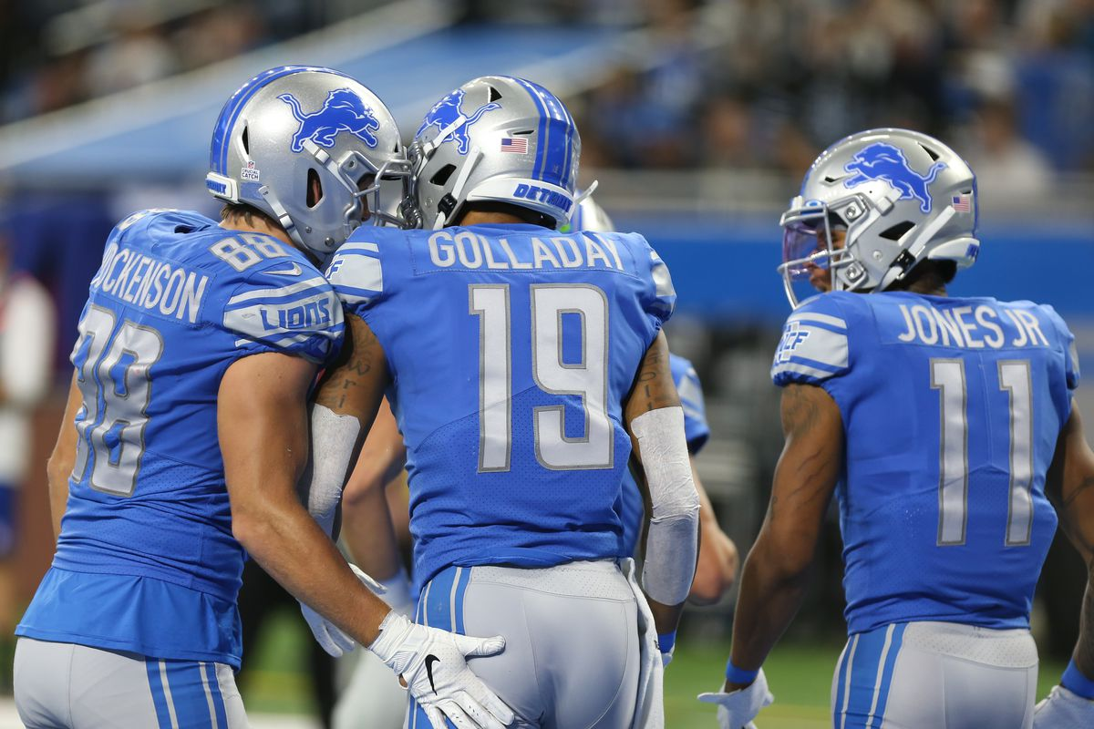 Detroit Lions wide receiver Kenny Golladay receives congratulations from tight end T.J. Hockenson and wide receiver Marvin Jones after scoring a touchdown during a regular season game between the New York Giants and the Detroit Lions on October 27, 2019 at Ford Field in Detroit, Michigan.