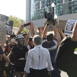 Protesters decrying the police shooting of Bernardo Palacios-Carbajalblock the media from covering the event in Salt Lake City on Thursday, July 9, 2020.