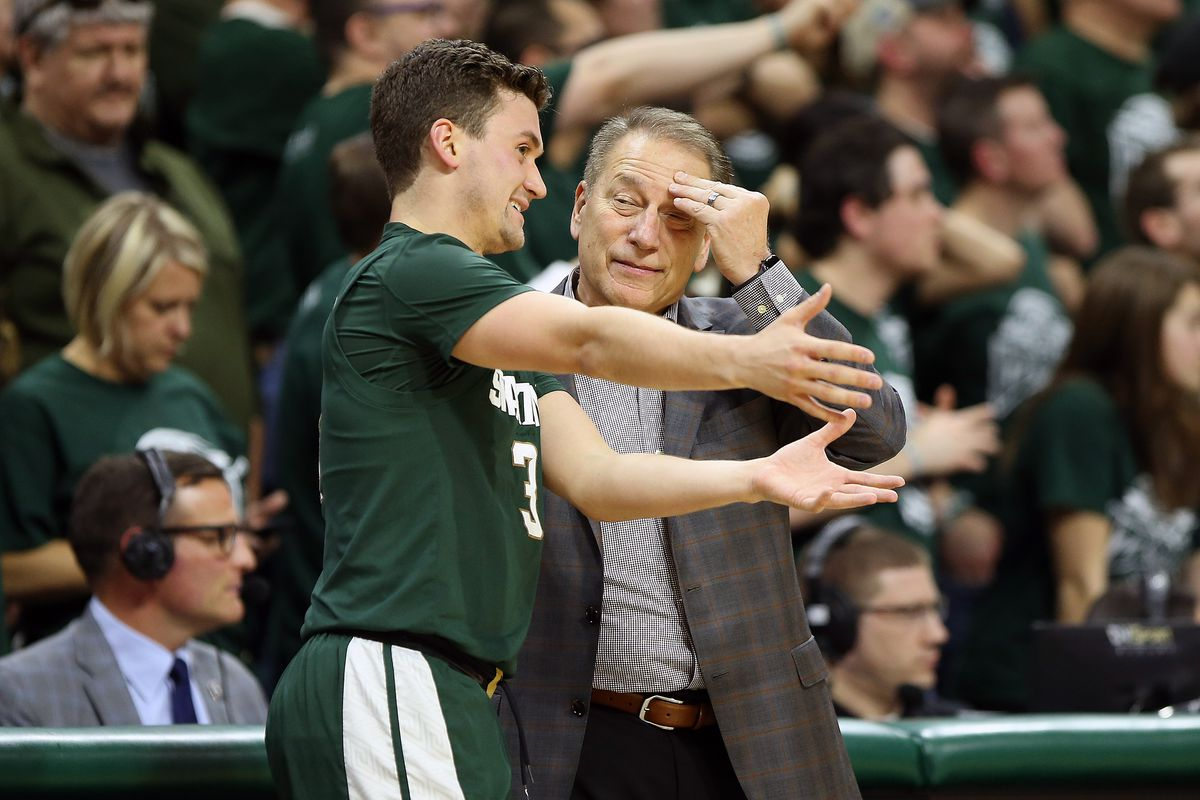 Michigan State Spartans head coach Tom Izzo listens to Michigan State Spartans guard Foster Loyer during the second half of a game at the Breslin Center.