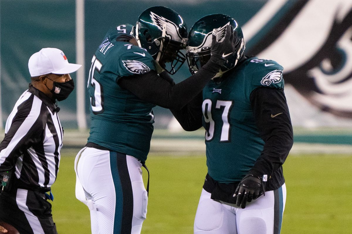 Philadelphia Eagles defensive end Vinny Curry (75) celebrates with defensive tackle Malik Jackson (97) after a sack against the Dallas Cowboys during the first quarter at Lincoln Financial Field.