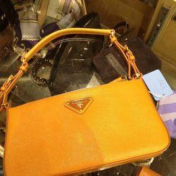 Prada clutch, $175