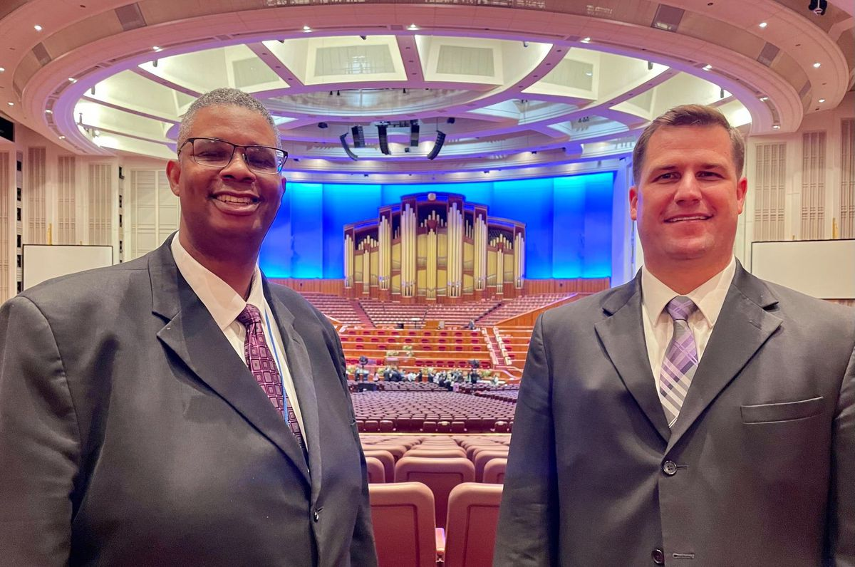 Thom Reed, left, and Brian Brown are members of a multicultural choir that will perform during general conference.