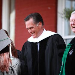Mitt Romney and Southern Virginia University President Paul K. Sybrowsky greet members of the class of 2013 on April 27, 2013.