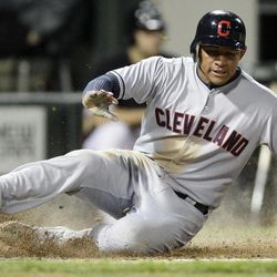 Cleveland Indians' Ezequiel Carrera scores on a single hit by Jason Kipnis during the fourth inning of a baseball game against the Chicago White Sox in Chicago, Wednesday, Sept. 26, 2012.